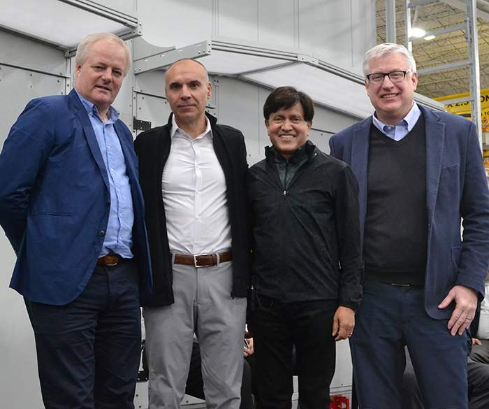 """, """"Simon Peckham, Bruno Biasiotta, Kris Holla, and Kevin Facinelli celebrating the delivery and signing of the first manufactured StatePoint™ Liquid Cooling (SPLC) system"""